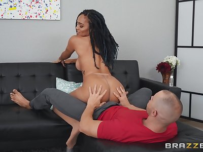 sexy brunette Julie Kay jumping on a friend's penis on the couch